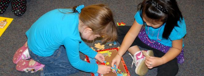 two girls with puzzle