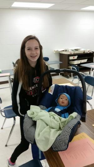 FACS student with baby