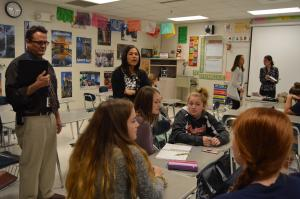 Education Commissioner talks with students in the classroom during LEAP