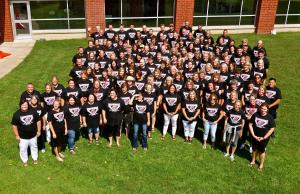 Centennial Middle School staff in 20th anniversary t-shirts