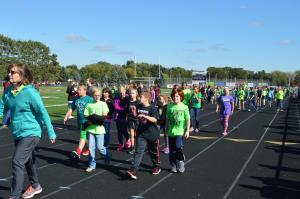 Centennial Elementary students walking the track at the high school.