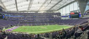 Panoramic view inside US Bank Stadium where the girls are playing on the field and the fans are in the stands