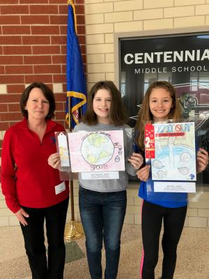 Sixth grade students with their winning posters.