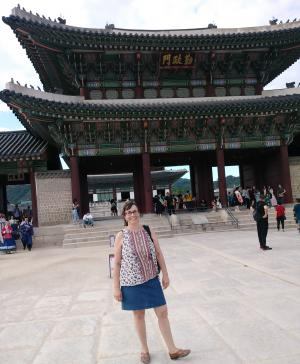 Julie standing in front of a temple in Korea
