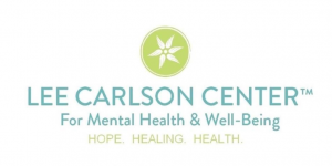 Logo of the Lee Carlson Center--green circle with white star