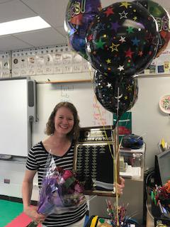Megan Fritz, Teacher of the Year, with balloons and flowers