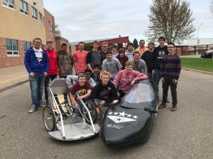 Students with two cars they built and designed