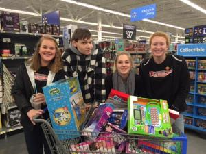 students leading a toys for tots drive