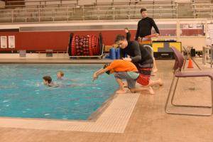 An instructor teaching diving skills