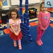 Kids having fun stacking cups
