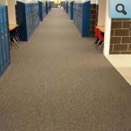 Hallway with new carpeting and lockers