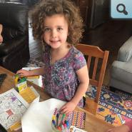 Young student coloring at a table