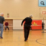 adults playing pickle ball
