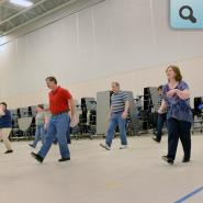 Adults participating in Line Dancing