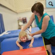Student and parent participating in gymnastics