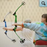 Adults participating in Archery