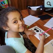 Young student writing in workbook