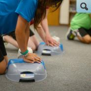 Students participating in CPR training