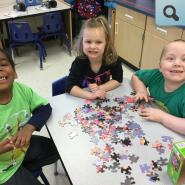 Kids working on a puzzle
