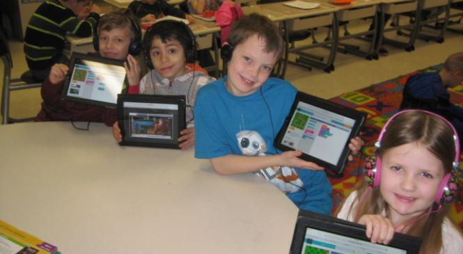 a group of students showing work on their iPads
