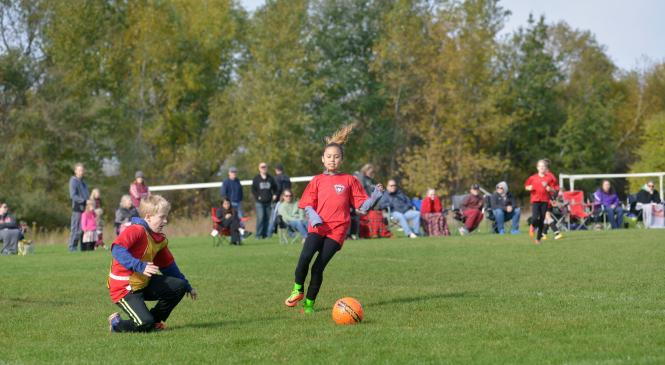 A student playing soccer