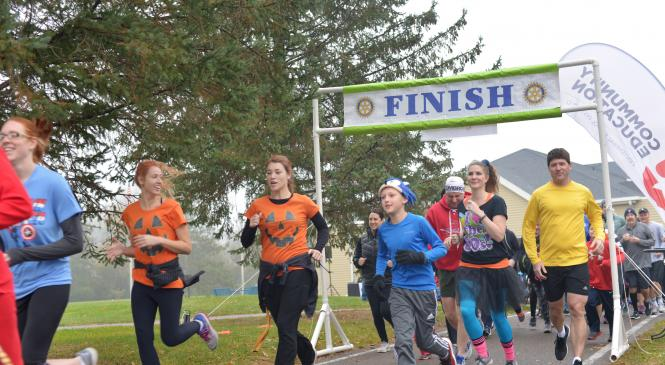 a photo of participants of a 5K running at the starting line