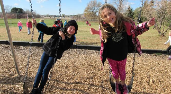 two students swinging