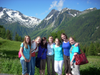 students with Swiss Alps photo